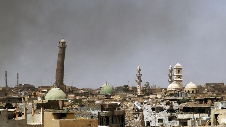 Het beroemde gebouw in het oude stadsdeel van Mosoel, met zijn iconische scheve minaret, voor de verwoesting. Beeld afp