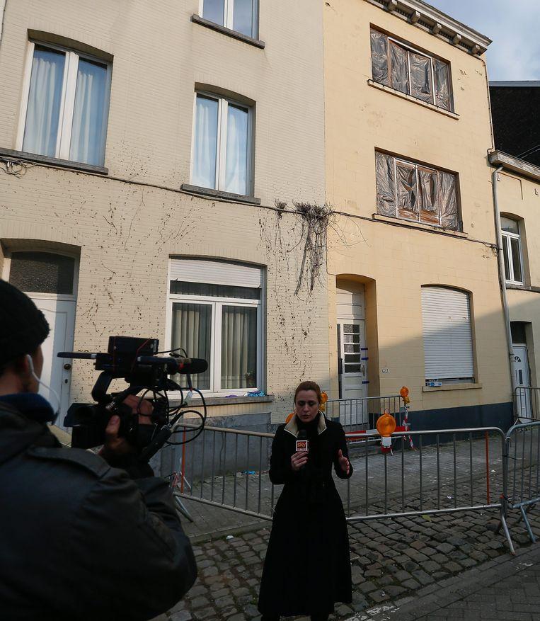 Het huis in Vorst waar de politie afgelopen dinsdag een huiszoeking deed. Beeld EPA