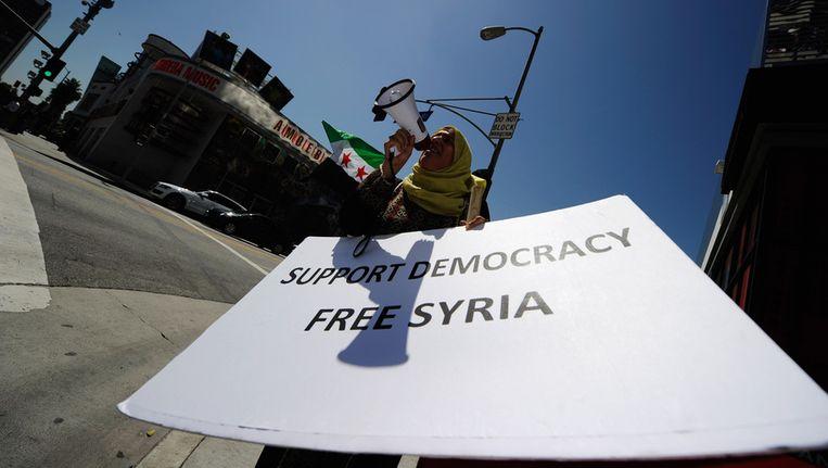 Demonstranten willen democtratie in Syrië en eisen hervormingen. Beeld getty