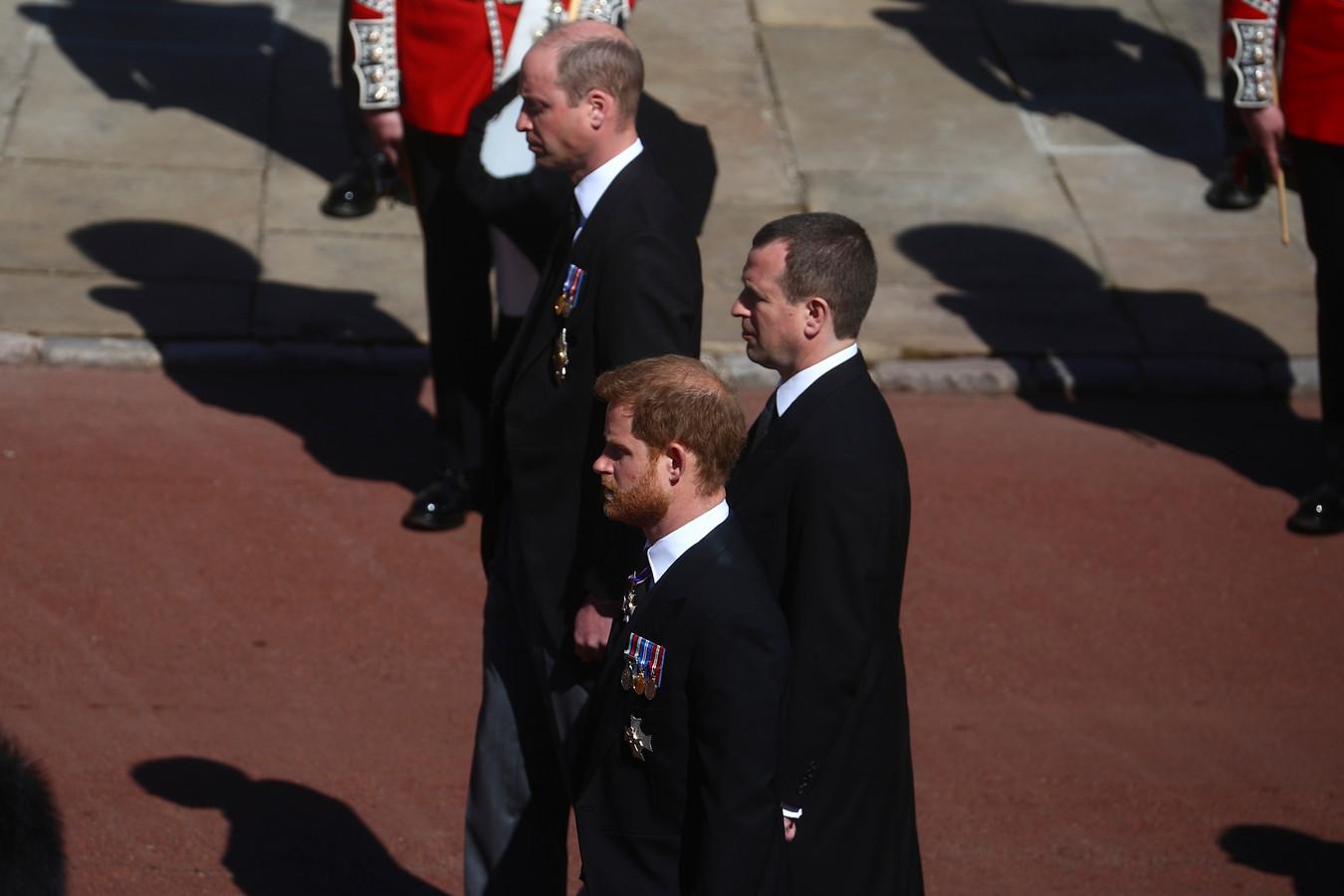 Harry en William, met Peter Philips tussen hen in.