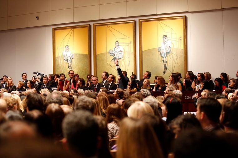 Francis Bacons 'Three Portaits of Lucian Freud' was tot vannacht het duurst geveilde schilderwerk ooit. Beeld REUTERS