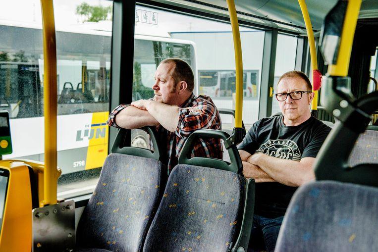 Buschauffeurs Stefaan en Dirk (bril) werden  allebei het slachtoffer van geweld op de bus. Beeld Eric de Mildt