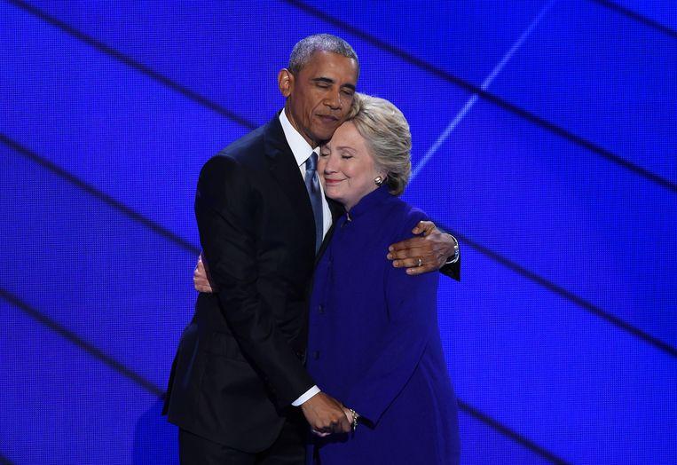 Hillary Clinton afgelopen zomer op campagne met uittredend president Barack Obama. Beeld AFP