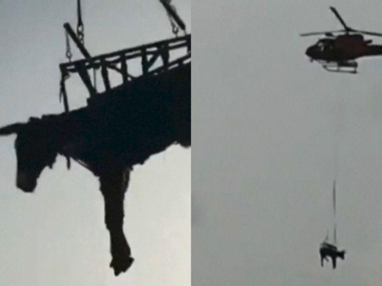 Bizar tafereel boven Spaans landschap: hopelijk heeft deze ezel geen hoogtevrees