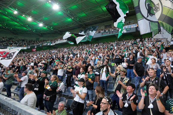 Spectators cheer during the German Bundesliga soccer match between Borussia Moenchengladbach and Bayern Munich in Moenchengladbach, Germany, Friday, Aug. 13, 2021. (AP Photo/Martin Meissner)