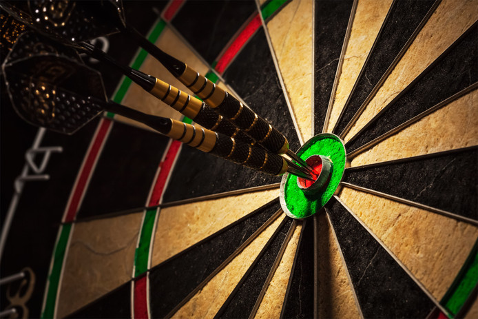 Success hitting target aim goal achievement concept background - three darts in bull's eye close up darts stockadr Getty Images