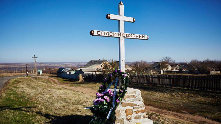 Herdenkingskruis ter nagedachtenis van de ramp Beeld anp