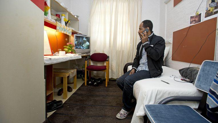 Een asielzoeker in de Vluchthaven Beeld ANP