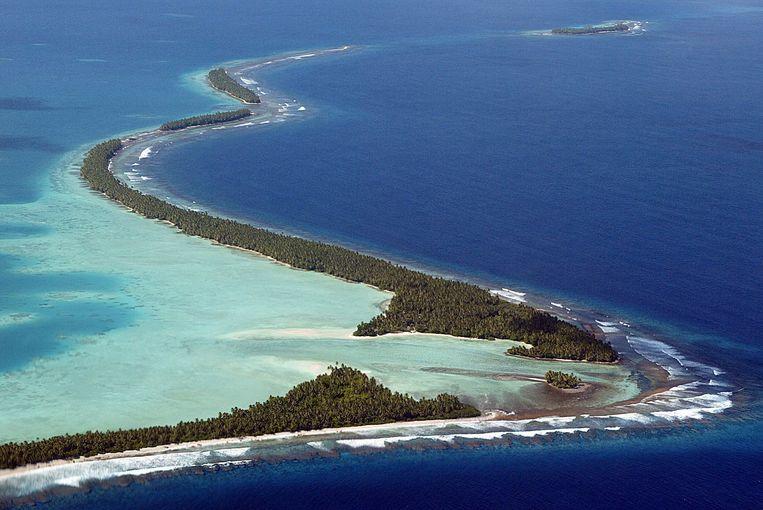 De kust van Funafuti, Tuvalu. Het leven wordt er steeds zwaarder vanwege de stijgende zeepsiegel Beeld AFP