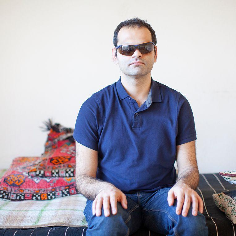 De blinde asielzoeker Ahmad Heidari. Beeld Harry Cock