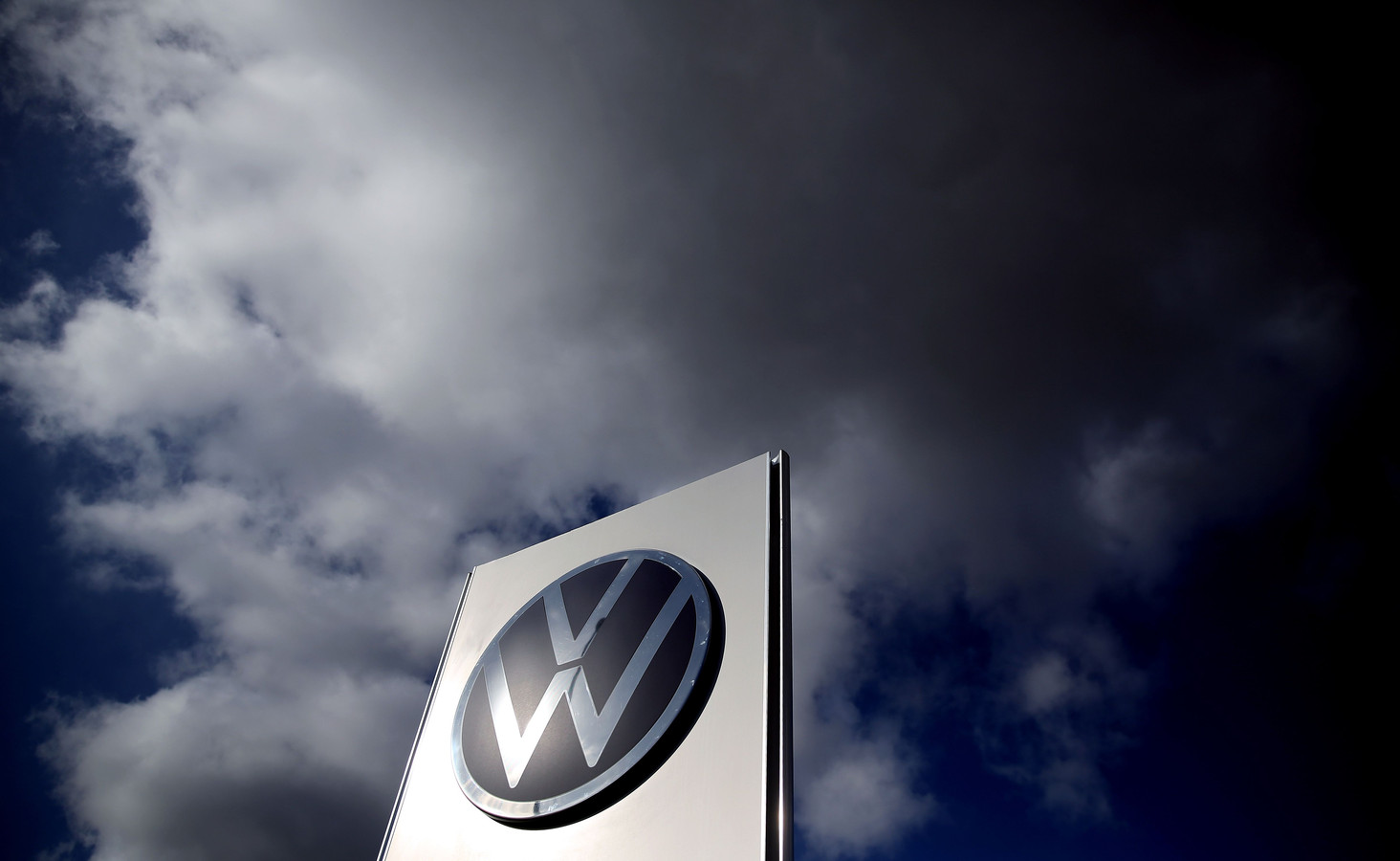 """(FILES) In this file photo taken on February 28, 2020 The logo of German car maker Volkswagen (VW) is pictured at the company's headquarters in Wolfsburg. - German auto giant Volkswagen said on March 17, 2020 it was preparing to shutter most of its European plants, joining a slew of other carmakers as the coronavirus pandemic disrupts supply chains and sends demand plummeting. Production will be halted in Spain, Portugal and Slovakia and Italy before the end of this week,"""" CEO Herbert Diess said in a speech. (Photo by Ronny Hartmann / AFP)"""
