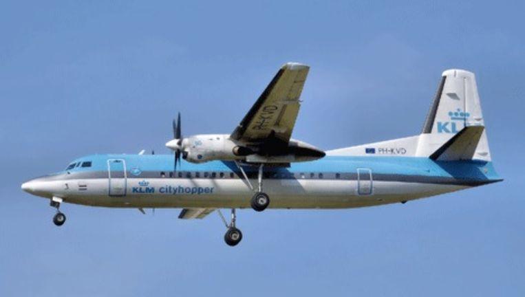 Fokker 50/KLM Cityhopper tijdens de landing. Foto Het Parool Beeld