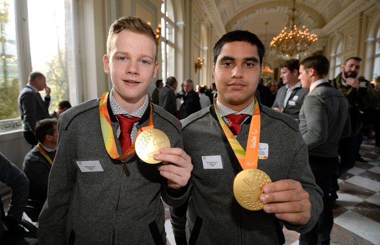 Paralympiërs Laurens Devos en Florian Van Acker. Beeld Photo News