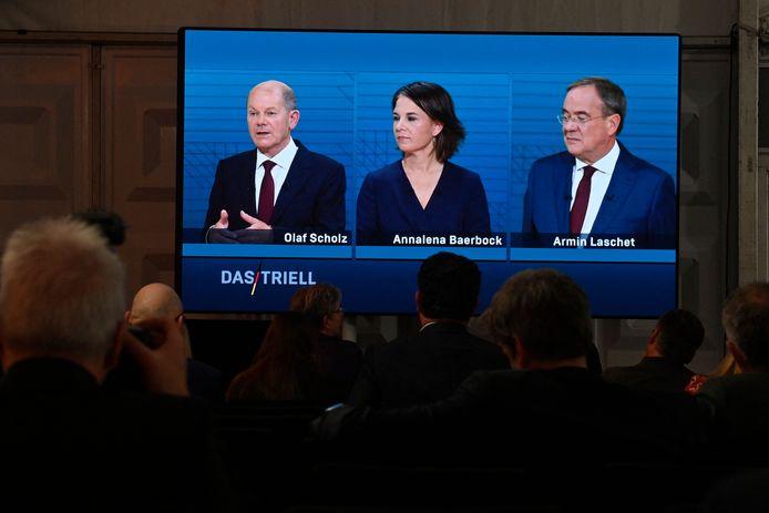 Het tv-debat op de publieke zenders ARD en ZDF met vlnr SPD-kandidaat Olaf Scholz, Annalena Baerbock van de Groenen en Armin Laschet van de CDU/CSU.