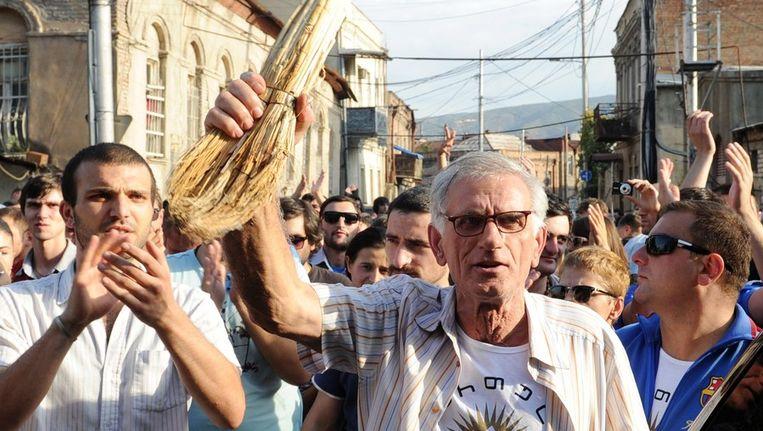Protest in de Georgische hoofdstad Tbilisi tegen de mishandelingen in gevangenissen. Beeld AFP
