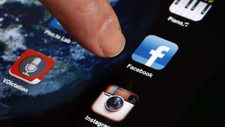 Apps op een smartphone. Beeld AFP