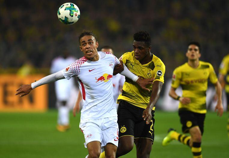 Poulsen houdt de Franse Dortmund-verdediger Zagadou af. Beeld afp