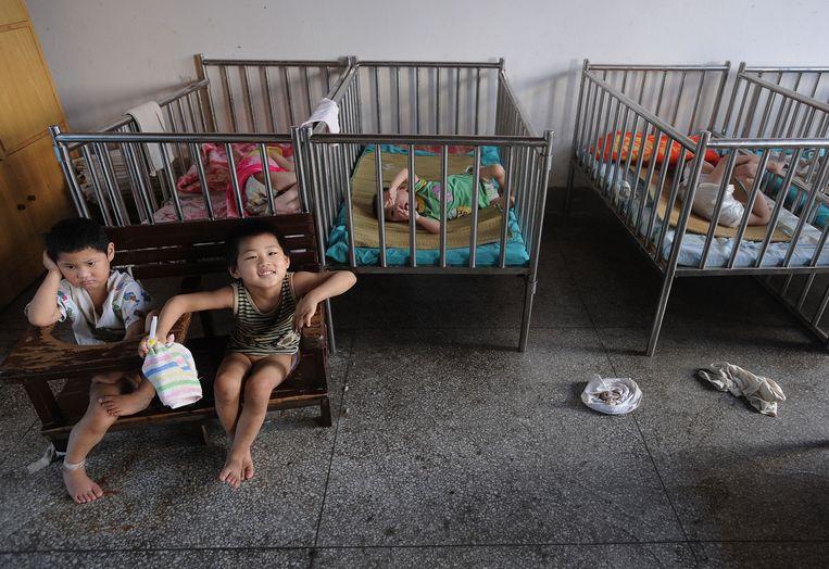 Kinderen in een weeshuis in Wuhu, Oost-China in 2009.  Beeld ANP