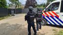 Politie bij de twee loodsen in Nederweert.