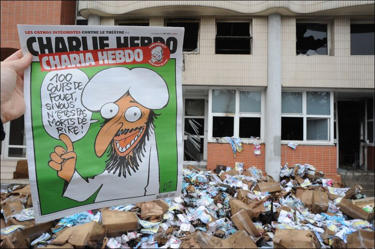 De verwoeste redactie van Charlie Hebdo na de aanval met een molotovcocktail in 2011. Beeld PHOTO_NEWS