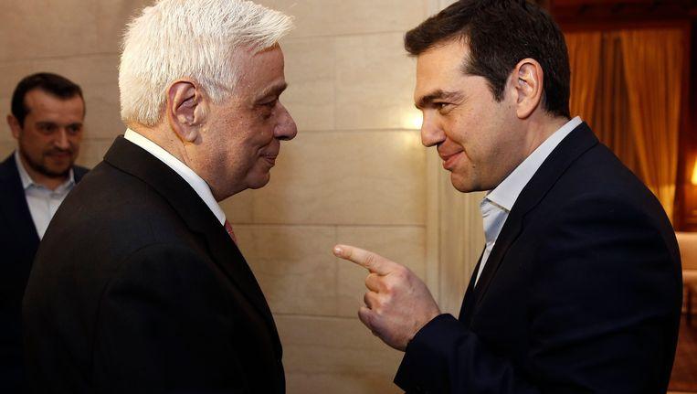 Prokopis Pavlopoulos en Alex Tsipras. Beeld REUTERS
