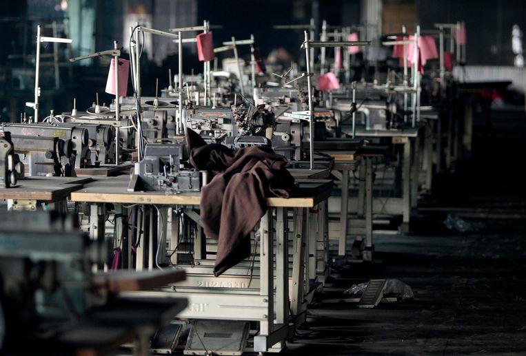 H&M blijft vasthouden aan haar fabrieken in Bangladesh, waardoor het langer duurt eer een stuk in de winkels ligt en er dus minder snel kan worden ingespeeld op modetrends. Beeld AP