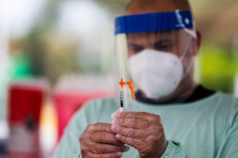 In Puerto Rico wordt een nationale feestdag gebruikt om zoveel mogelijk mensen te vaccineren.  Beeld AP