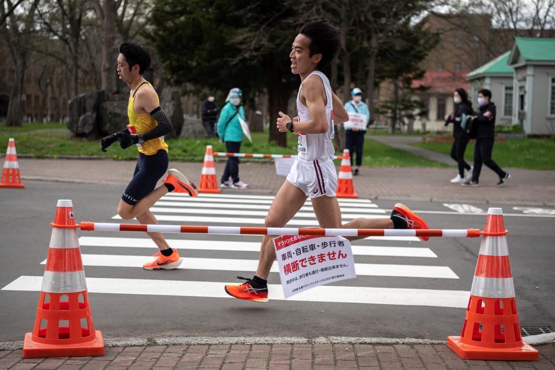Marathonlopers tijdens een olympisch testevent in Sapporo, begin mei. Beeld AFP