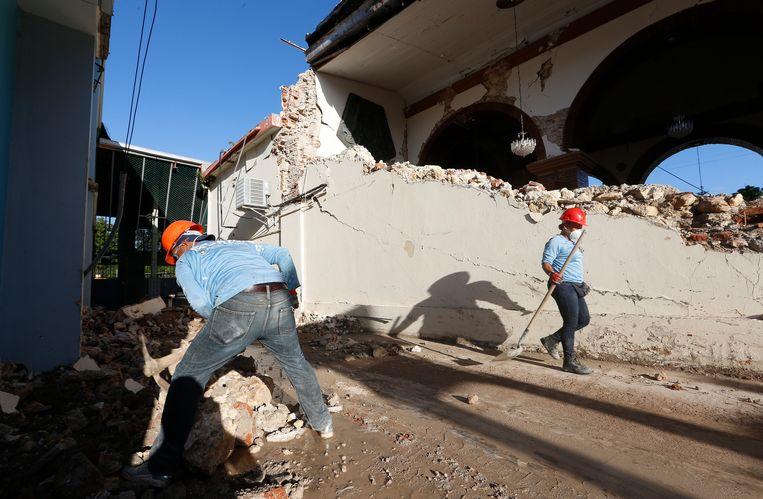 De schade aan gebouwen in het getroffen Guayanilla is groot. Beeld Getty Images