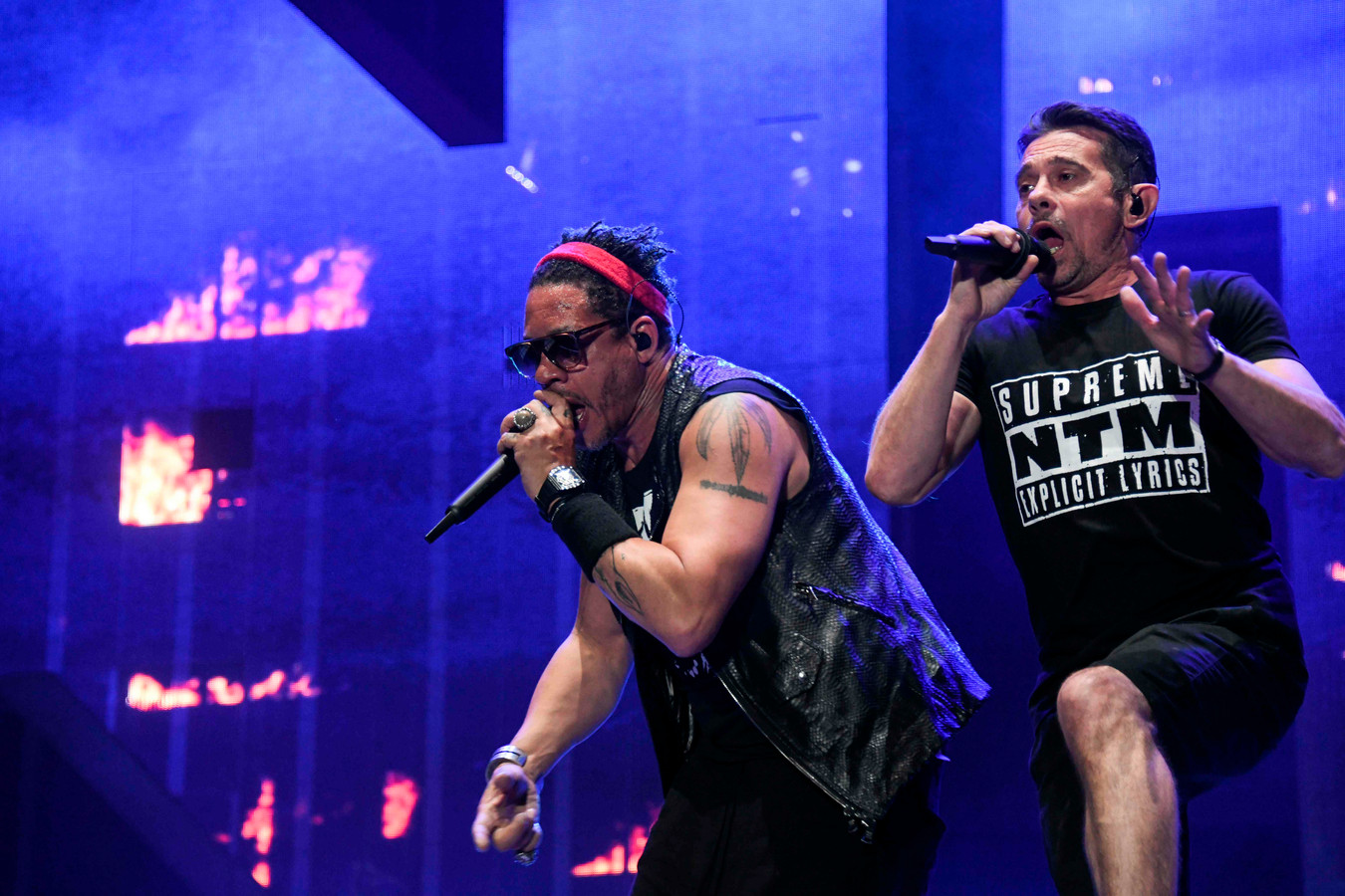 French singers Joey Starr (L) and Kool Shen (R) from the French band NTM perform on stage during the 31st Eurockeennes rock music festival in Belfort, eastern France, on July 4, 2019. (Photo by SEBASTIEN BOZON / AFP)