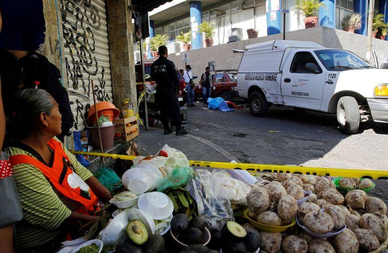 Politie op een plaats delict in Chilpancingo. Beeld REUTERS