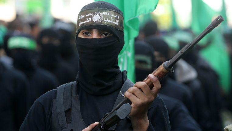 Hamasstrijders bij een parade in Gaza-stad. Beeld AFP