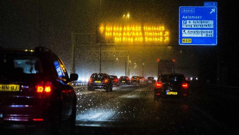 Ter illustratie: Verkeer trotseert de sneeuw op snelweg A9 nabij Amstelveen Beeld anp
