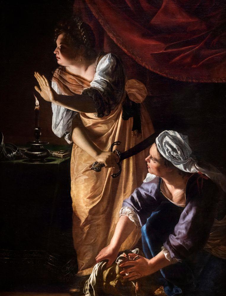 Het stopgebaar van Judith is voor de kunstenaar een heerlijk excuus  om licht van schaduw te scheiden.  Beeld Alamy Stock Photo