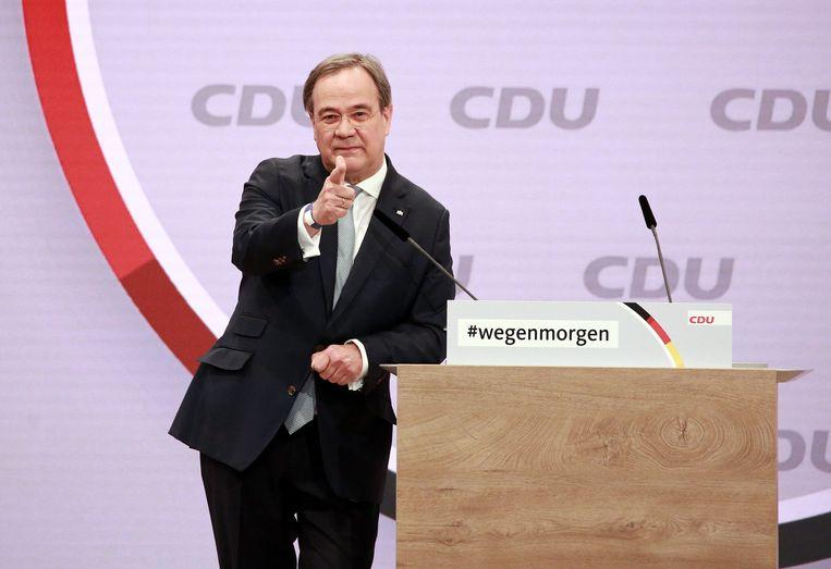 Armin Laschet spreekt tijdens het virtuele partijcongres van de CDU. Hij won de strijd om het partijvoorzitterschap. Beeld EPA