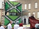Demonstranten toonden vorige maand een nieuwe vlag van de Achterhoek: met windmolens.