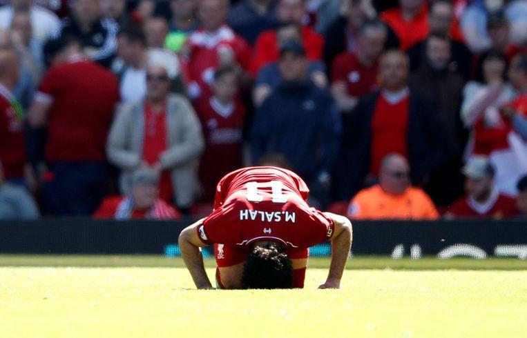 Mo Salah knielt altijd nadat hij scoort, en vele Britse schoolkinderen volgen zijn voorbeeld.  Beeld Photo News