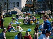 Eerste zomerse dag is een feit, Amsterdam en Tilburg sluiten parken vanwege drukte