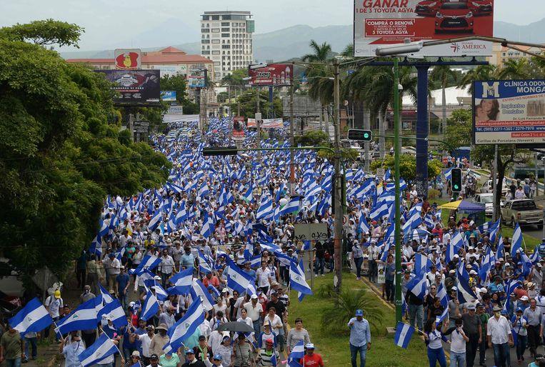 Nationale protestmars in Nicaragua genaamd: 'samen zijn we een vulkaan'. Beeld AFP
