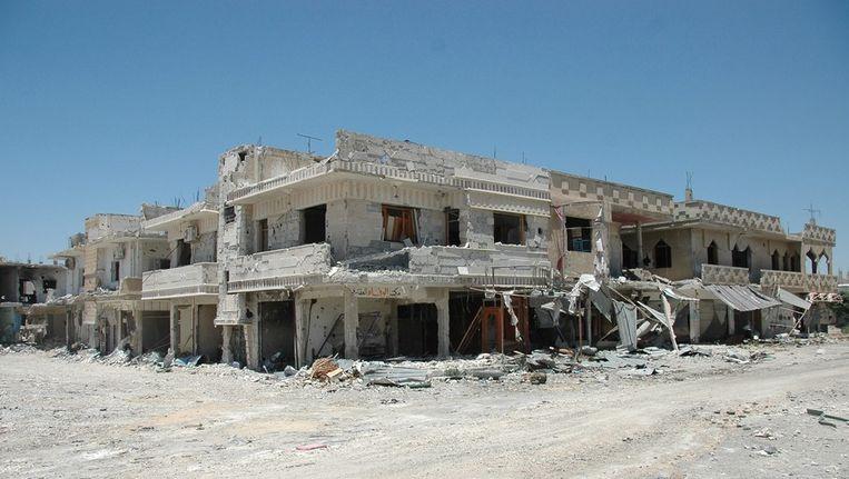 Beschadigde gebouwen in de Syrische stad Qusair Beeld anp