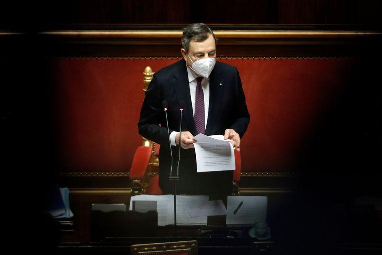 Italiaans interim-premier Mario Draghi stelt het herstelplan voor zijn land voor in de Senaat. Italië geldt als het zorgenkindje van de eurozone. Beeld Photo News