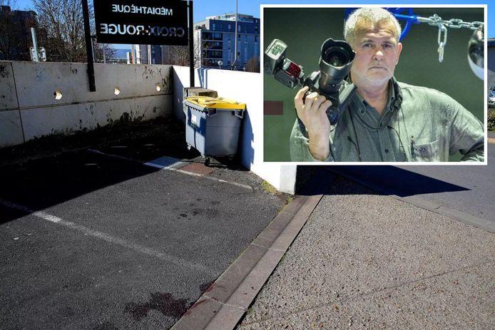 Persfotograaf Christian Lantenois (65) (inzet) werd zaterdag zwaargewond aangetroffen op deze parking in de probleemwijk Croix-Rouge in Reims. Onderaan de foto zijn nog bloedsporen te zien.