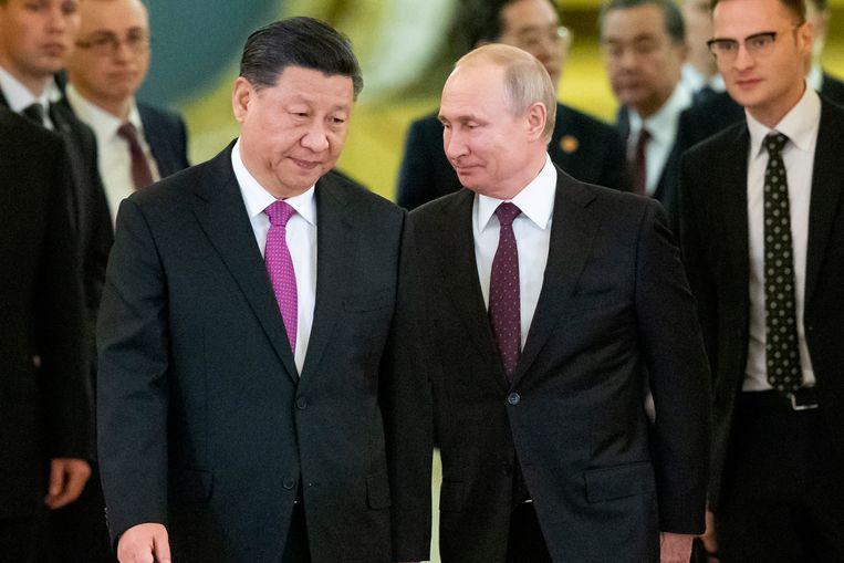 Chinees president Xi Jinping en zijn Russische collega Vladimir Putin. Biscop: 'Het prioritaire toneel voor de VS is Azië. Europa is secundair geworden.' Beeld AP
