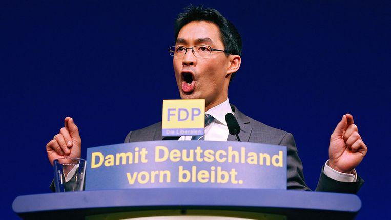 FDP-leider Philipp Rösler zondag tijdens het nieuwjaarscongres van zijn partij. Beeld getty