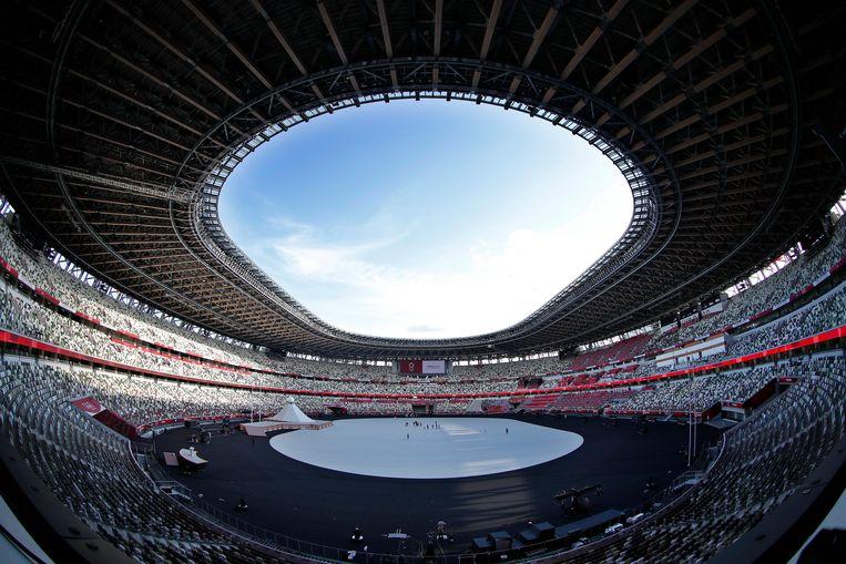 Het stadion voor de openingsceremonie. Publiek zal er niet te zien of te horen zijn.  Beeld EPA