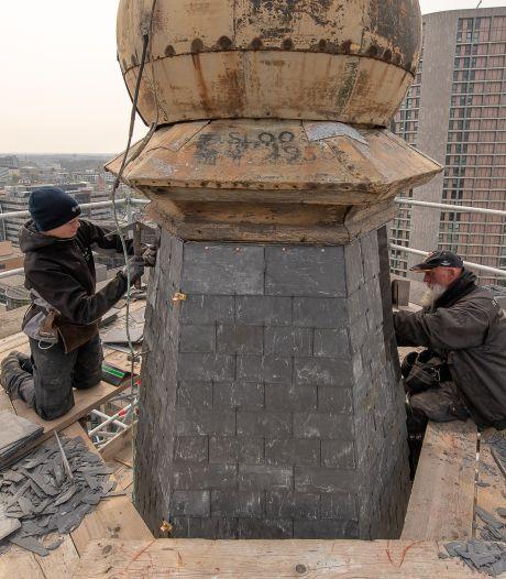 Van een leien dakje op grote hoogte: werk aan de torenspits van de Paterskerk in Eindhoven