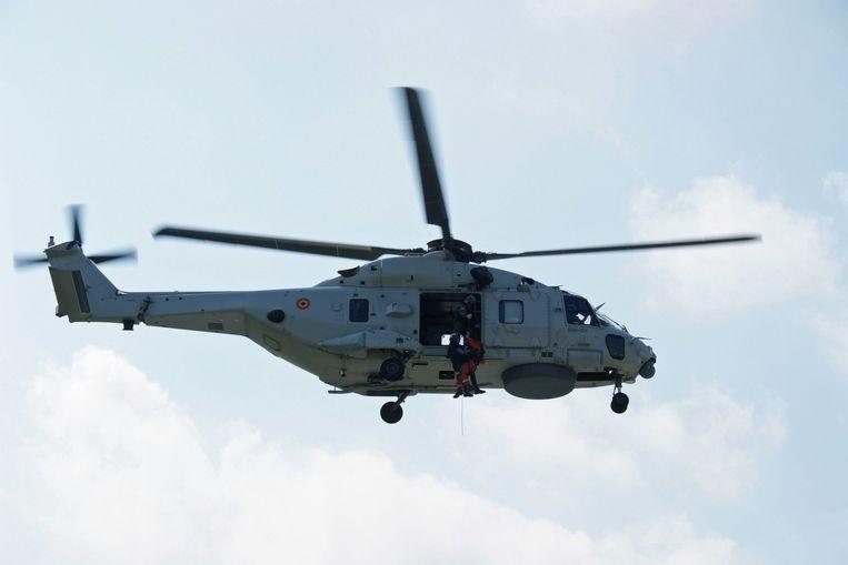 De grijze variant die onder meer de reddingsacties boven zee vanuit Koksijde uitvoert, zou wel blijven vliegen. Beeld BELGA
