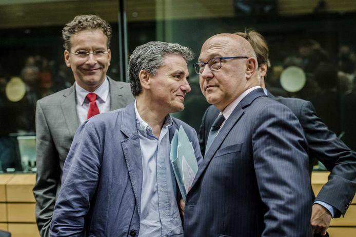 Voorzitter van de Eurogroep Jeroen Dijsselbloem, de nieuwe minister van Financien van Griekenland, Euklides Tsakalotos en minister van Financien van Frankrijk Michel Sapin.