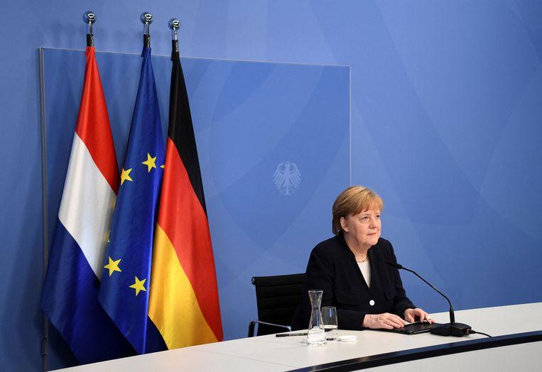 Angela Merkel vanuit Berlijn, tijdens haar toespraak ter ere van Bevrijdingsdag.  Beeld AFP