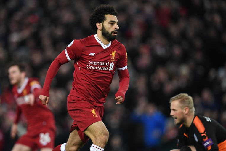 Liverpool's Egyptian midfielder Mohamed Salah celebrates scoring the team's first goal during the English Premier League football match between Liverpool and Leicester at Anfield in Liverpool, north west England on December 30, 2017. / AFP PHOTO / Paul ELLIS / RESTRICTED TO EDITORIAL USE. No use with unauthorized audio, video, data, fixture lists, club/league logos or 'live' services. Online in-match use limited to 75 images, no video emulation. No use in betting, games or single club/league/player publications.  /